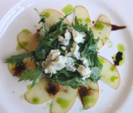arugula with honey-glazed apple carpaccio, blue cheese & cashew dust in champagne–cider vinaigrette