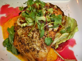 cabbage-wrapped, fennel pollen–dusted striped bass with carrot-ginger & citrus-jalapeño beet purees